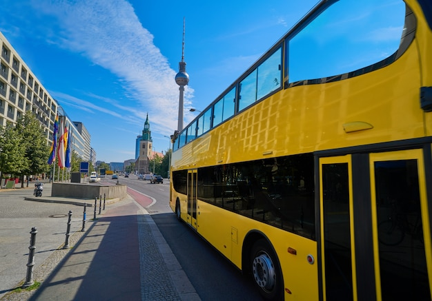 Berlin yellow tourist bus near berliner dom