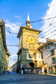 Bern, switzerland - 23 aug 2018: people on the shopping alley with the zytglogge astronomical clock tower of bern in switzerland