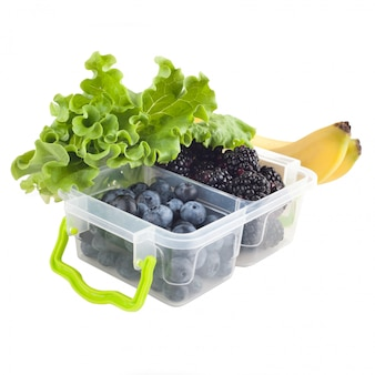 Berries in lunch box and fruits