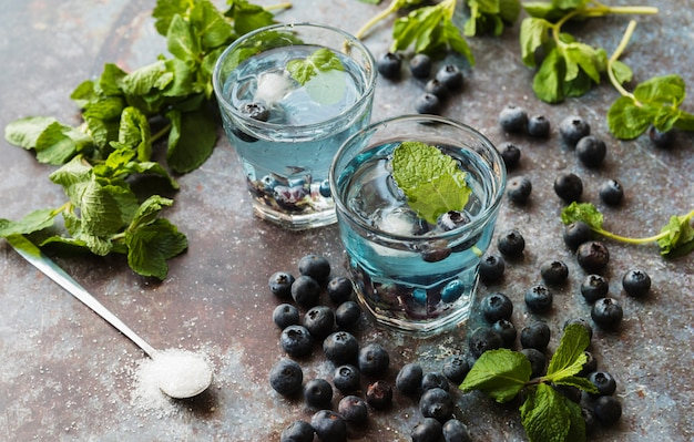 Berries and mint around refreshing blueberry drinks