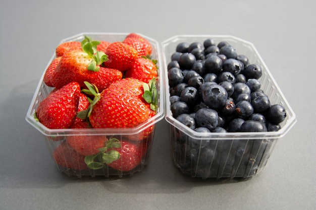 Berries in a plastic container. fresh strawberry and blueberry in plastic box