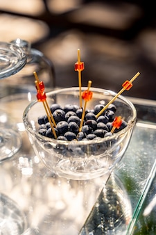 Berries on wedding reception. beautiful wedding candy bar with berries. wedding banquet table. closeup.