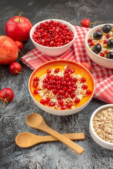 Berries wooden spoons cherries grapes oatmeal apples pomegranate