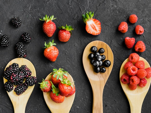 Berries on wooden spoons