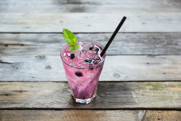 Berry cocktail in glass on wooden desk
