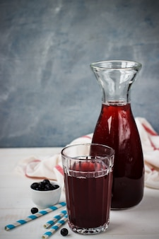 Berry drink from bilberry for health in glasswares