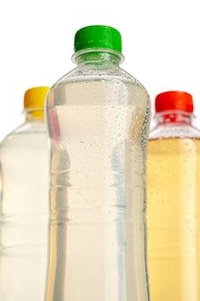 Berry lemonade in the bottles on the table