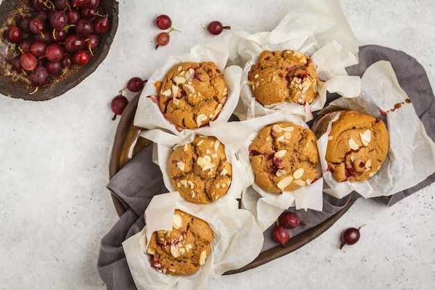 Berry oatmeal muffins on a white background, top view. healthy vegan dessert.