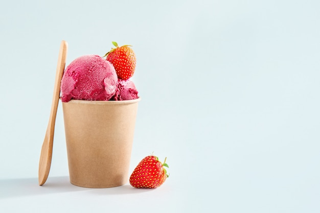 Berry refreshing ice cream scoops in paper cup