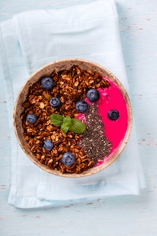 Berry smoothie oatmeal and granola with yogurt