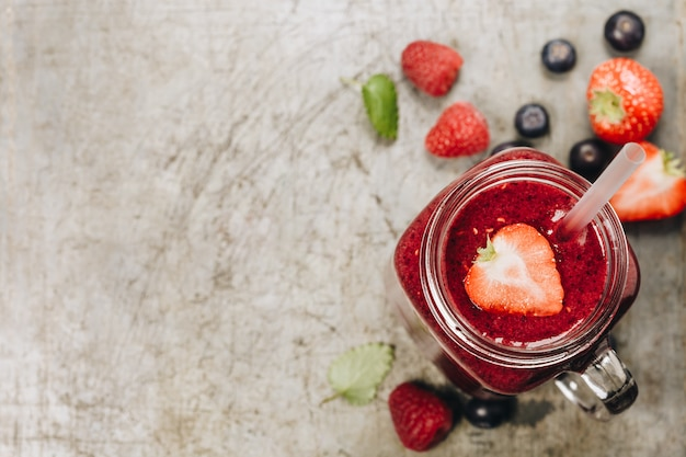 Berry smoothie on rustic