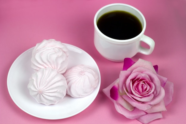 Berry zephyr and coffee cup on a pink background