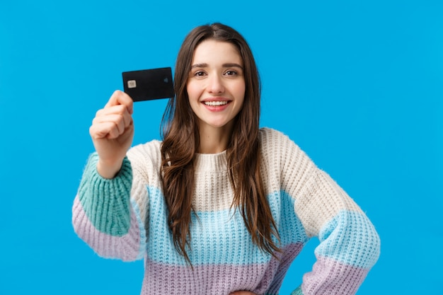Best bank for young generation. attractive pleased charismatic young woman in winter sweater