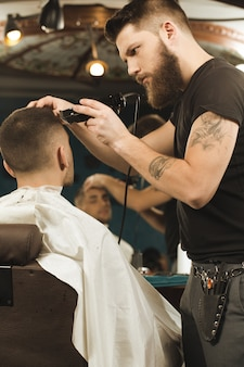 The best barber. vertical low angle shot of a barber working