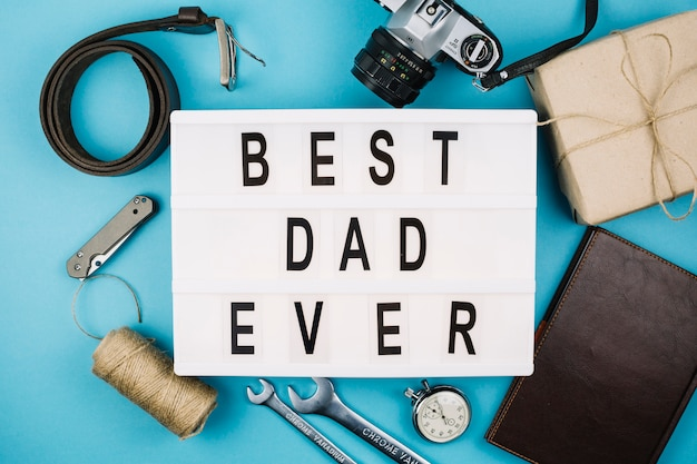 Best dad ever title on tablet near male accessories