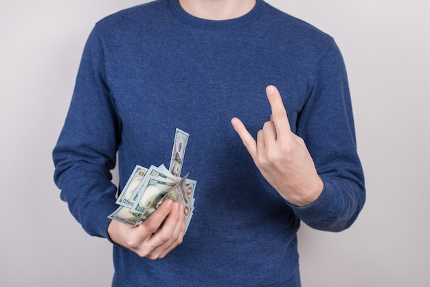 Best day ever concept. cropped closeup studio photo shot of satisfied mad emotional harsh brutal business businessman holding many much money in hand isolated grey background