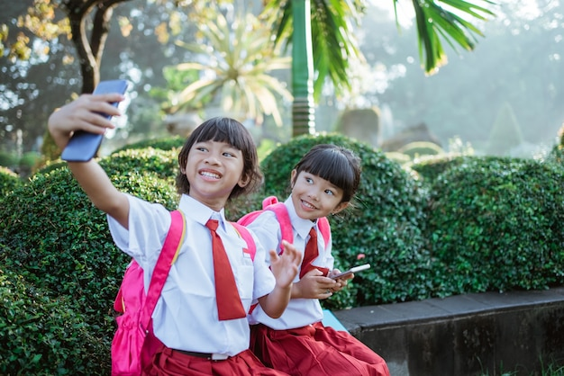 Best friend of indonesian primary school student take selfie
