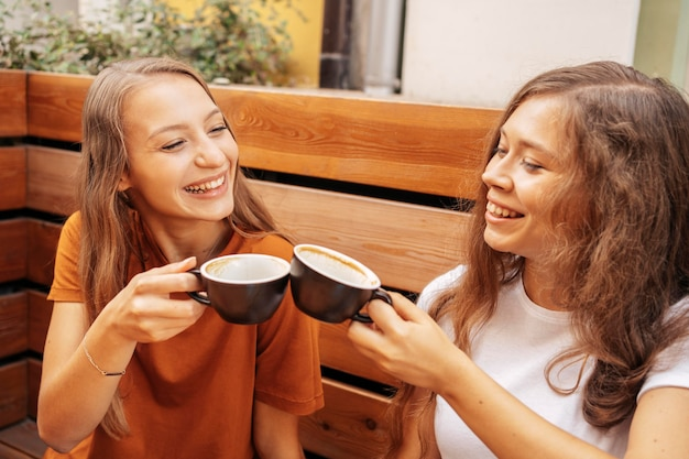 Best friends drinking coffee together