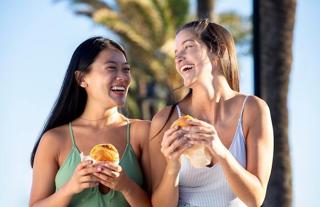Best friends eating street food together