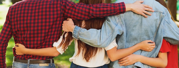 Best friends forever. group of young men and women hugging together. friendship and teamwork