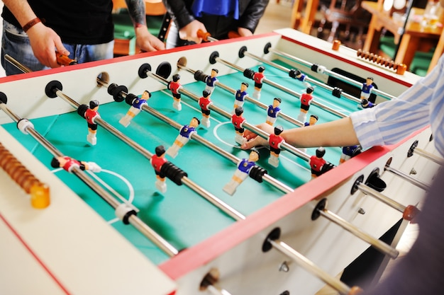 Best friends - guys and girls play table football.