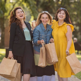 Best friends holding shopping bags