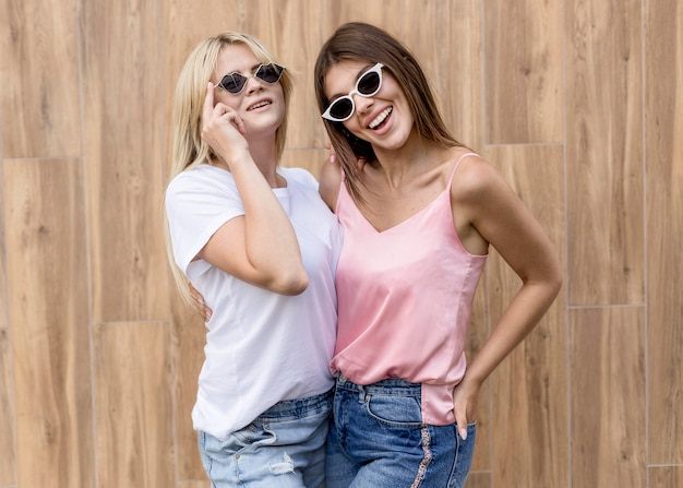 Best friends posing in a cute way on a wooden background