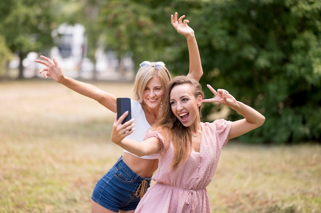 Best friends posing in a silly way for a selfie