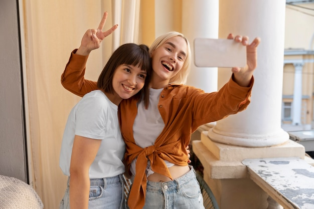 Best friends taking a selfie at a party
