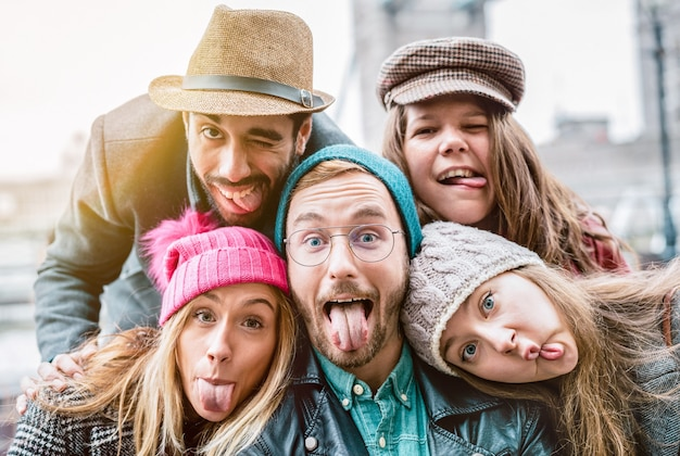 Best friends taking selfie on winter fashion clothes