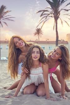 Best friends teen girls fun in a beach sunset