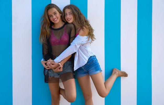 Best friends teen girls happy in summer beach