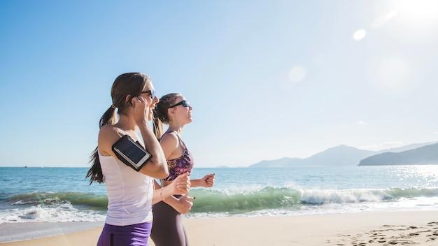 Best friends training on the beach
