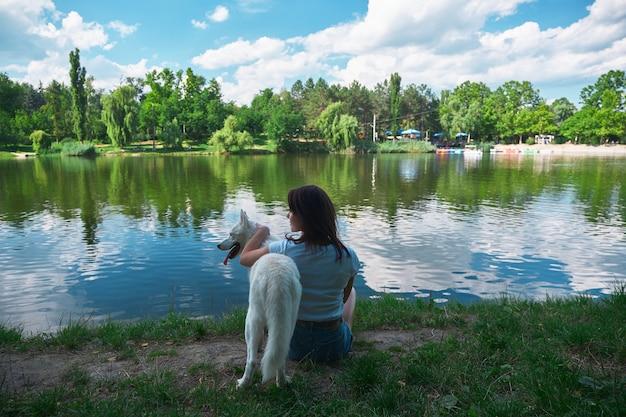 Best friends, woman hugging a dog