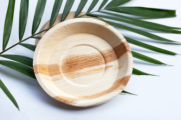 Betel palm leaf plates on white background.
