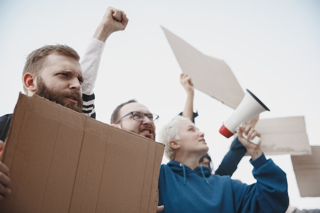 For better future group of activists giving slogans in a rally caucasian men and women marching