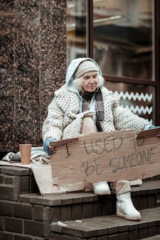 Better times. unhappy sad woman thinking about her past while being poor and homeless