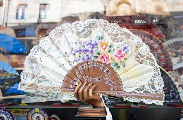 A beutiful painted spanish hand fan isolated in a souvenir shop in salamanca spain