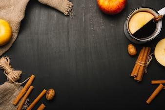 Beverage and cinnamon near cloth