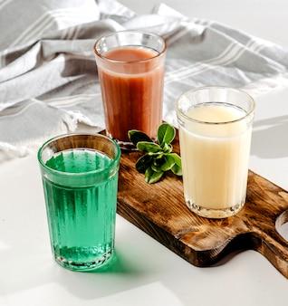 Beverages set on wooden board