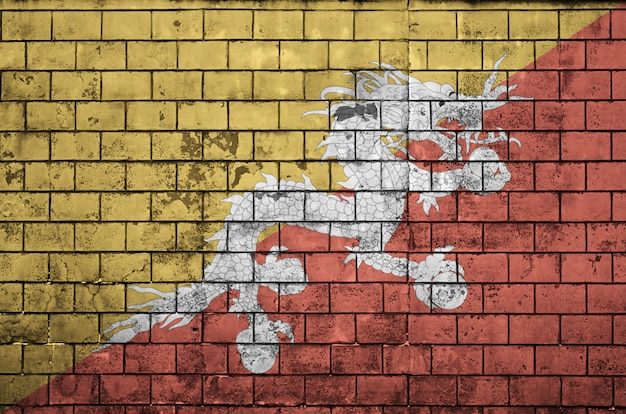 Bhutan flag is painted onto an old brick wall