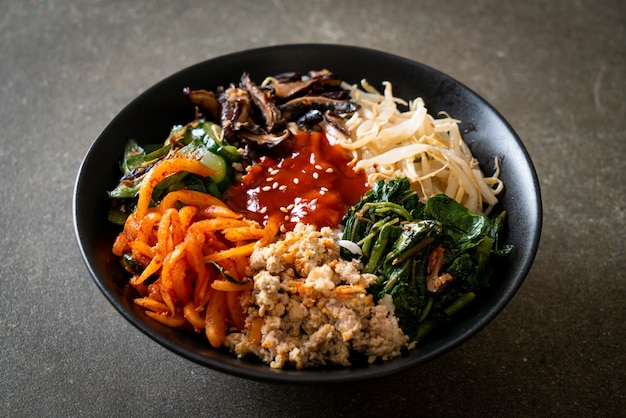 Bibimbap, korean spicy salad with rice bowl - traditionally korean food style