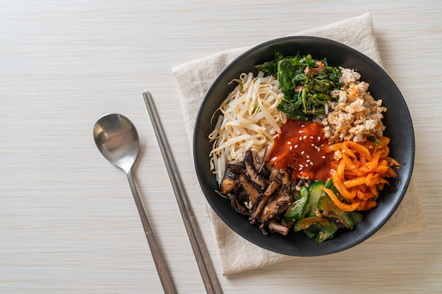Bibimbap, korean spicy salad with rice bowl