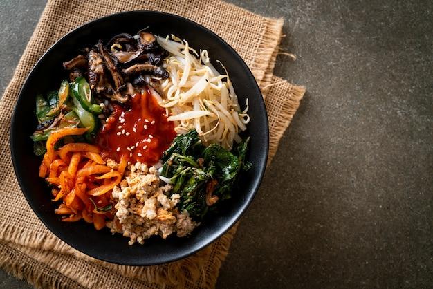 Bibimbap, korean spicy salad with rice bowl