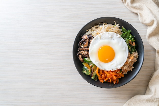 Bibimbap, korean spicy salad with rice and fried egg - traditionally korean food style