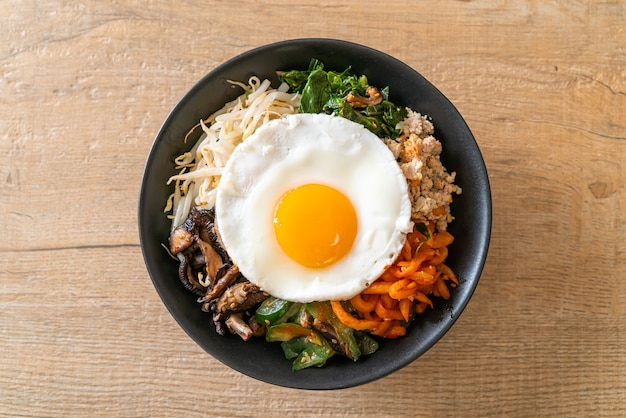Bibimbap, korean spicy salad with rice and fried egg