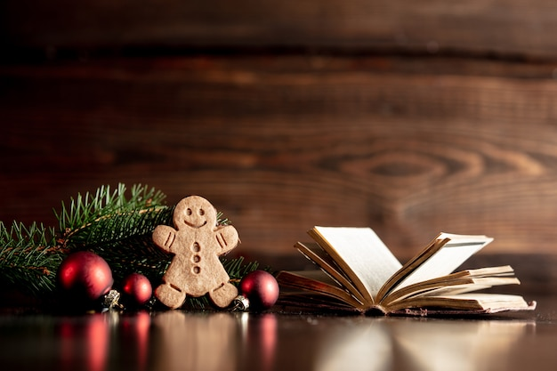 Bible book and gingerbread cookie on wooden table