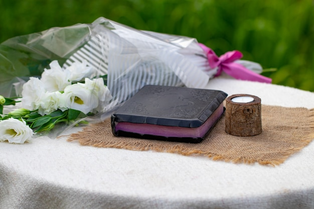 Bible and candle on a burlap napkin.