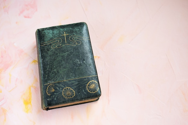 Bible or poetry book on pink