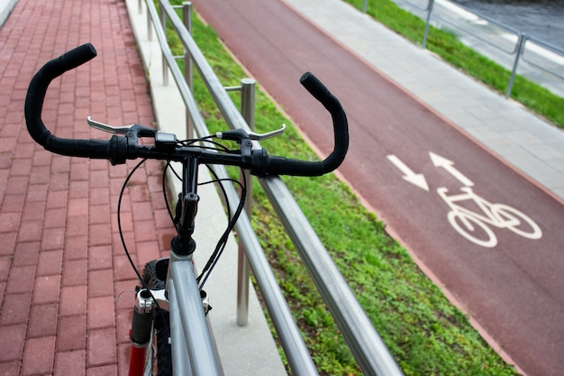 Bicycle on the background of city bike pathway with sign.